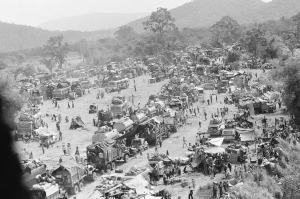 Hundreds of vehicles of all sports fill an empty area as the refugees fleeing in the vehicles pause near Tuy Hoa in the central coastal region of South Vietnam, Saturday, March 23, 1975 following the evacuation of Banmethuout and other population centers in the highlands to the west.