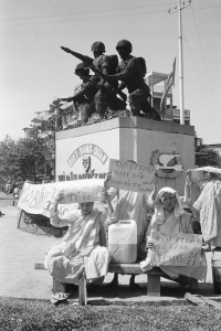 South Vietnamese Buddhist nuns opposed to the regime of President Nguyen Van Thieu and continued fighting in their country stage a demonstration in the shadow of a monument honoring combatants in Saigon, Jan. 27, 1975. The nuns called on Thieu to resign.