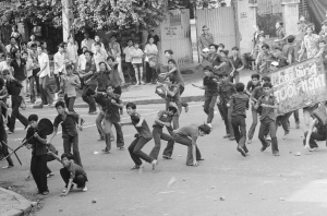 Rock throwing Saigon middle school students charge police during an anti-draft demonstration in Saigon, Thursday, March 27, 1975. The students were angered by changes in the conscription law, lowering the draft age to 17. The change came about due to the increasingly serious military situation.