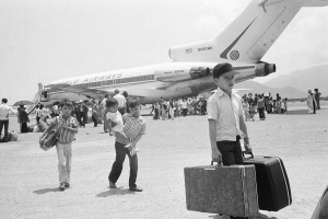 South Vietnamese refugee deplane at Nha Trang airfield in Vietnam, Thursday, March 27, 1975 following a jet hop from Danang as a U.S. financed airlift, using civilian chartered jets, relocates thousands of former residents of Hue.