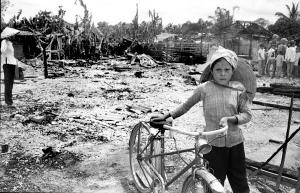 Photo 18-The blank stare of a Vietnamese girl mirrors the trauma of losing homes, friends and family. This was in the Da Nang area.