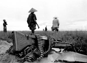Machine Gun At Ease-A heavy-duty M60 machine gun rests on the bank of a rice paddy during a rainy-day sweep by South Vietnamese troops in the Delta. Farmers working the paddies were rounded up and searched.