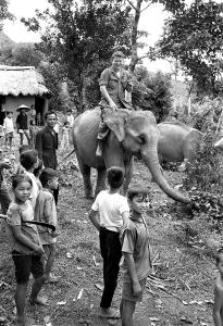 Photo 15--Winning the hearts and minds of the Vietnamese population was a slogan often heard during the Vietnamese War. In this case someone in the US Military got the idea that helping Vietnamese get back in the elephant business could possibly move hearts in that direction. UPI editor Dick Oliver got a short ride during an elephant operation in Tra Bong.