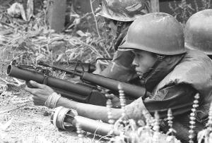 Vietnamese Airborne with M 79.-- A Vietnamese Airborne trooper lays low with his M79 grenade launcher pointing towards some noises  he and his comrades had heard earlier. After about 30 minutes his unit moved to higher ground. This action was only a few miles from  Tan Son Nhut Airport on the outskirts of Saigon. During the war it was one of the busiest airports in the world.