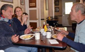 Vietnam veterans help other veterans regardless of the war. Here, Medal of Honor recipient John Baca, right, shares breakfast in Julian where he lives. From left, retired Marine Maj. William Mimiaga, Mary Ellen Bancroft, whose husband, Capt. Matthew Bancroft, was killed in Pakistan shortly after 9/11, and her daughter, Maddie.                      DAVID WHITING, STAFF